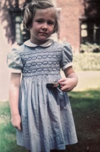 Photo of Sharon Brown holding crayons as a Toddler
